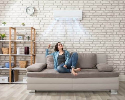 Woman-relaxing-under-the-air-conditioner